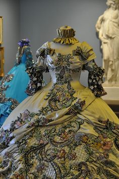 These dresses were made for the Society of Martha Washington Colonial Pageant and Ball in Laredo, Texas. And they are generally worn by 17 year old girls. Because no one else has a waist that small!