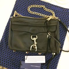 "Rebecca Minkoff Mini Mac Handbag Pre-owned. Used once. No flaws/damages. Comes with dust bag and original tags. Retails:195.00 +tax. 9"" wide x 1.5"" deep x 6.5"" tall Functioning front zipper pocket Adjustable chain strap can be worn cross-body (21"" drop) or doubled (14"" drop) Genuine leather. Custom silver hardware. Exclusive lining + dust bag Rebecca Minkoff Bags"