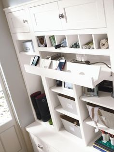 Decorá inset makes the most of a tight space, keeping storage tucked in and well behaved in a pretty alcove. Among other clever features, the pull-out charging station keeps electronics ready to go (add off kitchen counters).