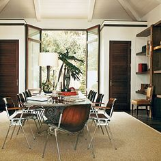 Bookcases lend a library feel to this dining room, while glass French doors let the light shine in.