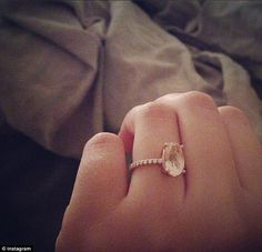 Stone of the heart: Teresa Palmer revealed her engagement ring featuring diamonds and a large rose quartz middle stone given to her by fiance Mark Webber on her Instagram page on Tuesday