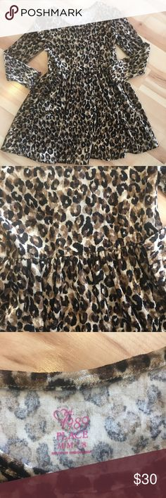 Children's Place Girls Dress Children's place Girls Dress medium 7/8 animal print.  Long sleeve knee length velvet material.  Great for the holiday get together or a dinner show.  Let your little girl be a little wild this season !! The Children's Place Dresses Casual