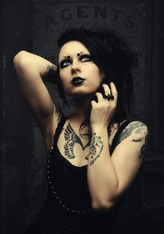 This #Goth girl has some excellent bat, gargoyle and personallzed tattoos