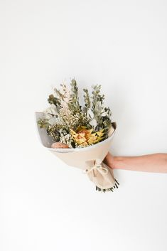 Everything is just peachy, just like this adorable dried flower bouquet with pops of peach peach, white, soft grey, pink and green. Find them online or within our dried flower bar. Flower Bar, Flower Show, Dried Flower Bouquet, Dried Flowers, Scabiosa Pods, Lotus Pods, Paper Daisy, Wheat Grass, Just Peachy