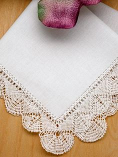 Queen Anne Bobbin Lace Ladies Handkerchief Decorated all around with a delicate regal bobbin lace design, this white lace ladies handkerchief is extremely delicate and eye pleasing.  Made from the finest cotton, this handkerchief is perfect for weddings and other special occasions.    Bobbin lace is handcrafted by weavers who use a braiding and twisting technique that is both labor and time intensive. The lace is called bobbin lace because it uses lots of bobbins that help preserve the lace…