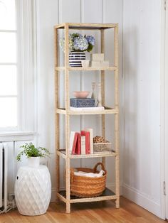 Ikea hack! Turn a basic shelving unit into an eye-catching decor piece with some natural sisal rope.