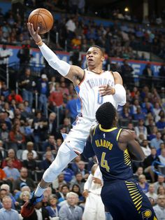 a8e9f5919 Oklahoma City s Russell Westbrook (0) goes to the basket past Indiana s  Victor Oladipo (