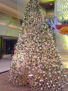 A very tall arrangement of bamboo cylinders with white gardenias forming an inverted cone like a christmas tree. All Things Christmas, Christmas Trees, White Gardenia, Gardenias, Go Green, Bamboo, Alternative, Holidays, Holiday Decor