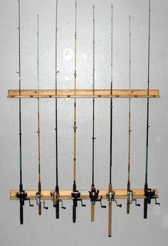For retail space with wire baskets underneath with fishing equipment (bobbers) in them. Fishing Rod Storage Rack Holds (8) Ceiling or Vertical on Wall. $106.00, via Etsy.