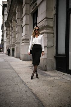 Mary Orton wears a classic white Rag and Bone blouse, a plaid ALC midi skirt, an AUrate New York diamond bezel necklace, bar necklace, bar earrings and tribar cuff