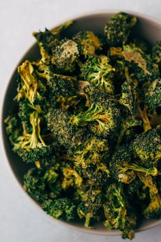 A bowl of dehydrated raw vegan cheezy broccoli chips