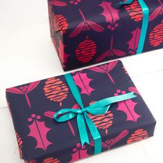 This is a set of luxury wrapping paper printed in a repeat pattern of fir cones, holly, and mistletoe.  Perfect for giving a blast of colour to your Christmas presents this year.  Each set contains 2 sheets of paper and 5m length of double stain blue ribbon.  Each sheet measures 50cm x 70cm and is printed on 100gsm recycled paper. It is the perfect thickness for wrapping, not too thin and not too thick.  The sheets are folded in this set.