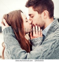 Happy Young Couple in Winter Park having fun.Family Outdoors. love kiss - stock photo