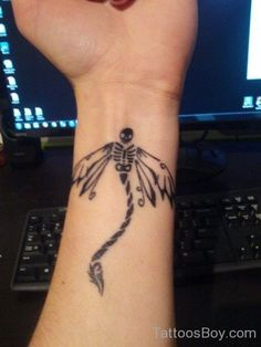 Skull Dragonfly Tattoo On Wrist would be cool but not exactly the look I'm going for.