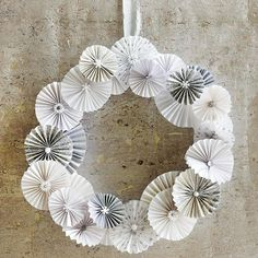 Use Paper to Make a Whimsical Christmas Wreath - what a fun idea! More festive wreath ideas: http://www.bhg.com/christmas/wreaths/christmas-wreaths/
