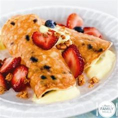 Blueberry Pancake Roll-Ups with Yogurt, Granola and Berries. A nice way to wake up!