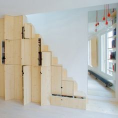 An alternating-tread staircase doubles as storage cupboards in this tiny Paris apartment by French architects Schemaa. | Tiny Homes