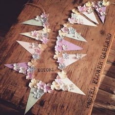 Paper and floral banner Diy And Crafts, Crafts For Kids, Paper Crafts, Flag Garland, Pastel Flowers, Flower Garlands, Paper Decorations, Diy Party, Diy Wedding