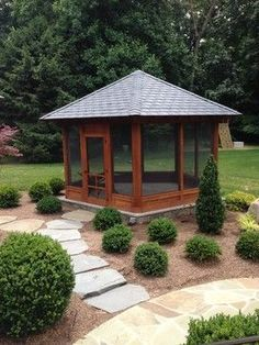 standalone screened porch on stone patio