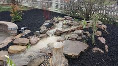 Our latest install in York, PA -- a beautiful pondless water feature with adjoining patio. Wouldn't you love a relaxing space like this in your yard? Contact us today! www.websterslandscaping.com  www.pond-contractor.services/websters-landscaping-york-pa.html