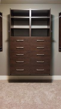 Walk-in Closet in our Chocolate finish. Clean contemporary style suits any decor. Brushed Nickel Contour Pulls.
