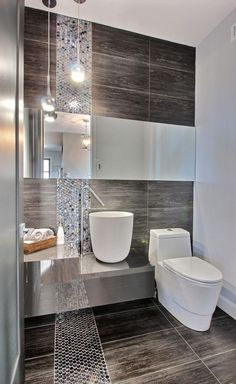 Contemporary bathrooms work best when each individual aspect complements the next, as is the case here.