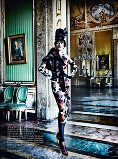 Australian model Catherine McNeil, in the September 2013 issue of British Vogue, photographed by Mario Testino at The Reggia Di Caserta wears: silk organza dress by Emilia Wickstead, snakeskin shoes by Casadei, shearling stole from The Throw Company, gloves by Ralph Lauren, flower hat by Elena Dawson.