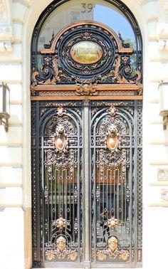 Entrance gate to building Metropolis, Gran Vía, Madrid,