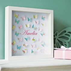 A white box frame full of fluttering paper butterflies artwork which surround your chosen personalised name. Each butterfly is mounted with its wings slightly b Butterfly Artwork, Butterfly Nursery, Butterfly Pictures, Paper Butterflies, Butterfly Frame, Baby Crafts, Diy And Crafts, Cuadros Diy, Craft Projects