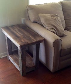Barn wood end table I built from an old barn in my field   Here's what it looks like next to the couch.
