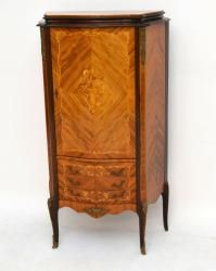 Antique French style Kingwood cabinet with some fine marquetry & inlays. It also has gilt metal handles & mounts. The top cupboard opens up to reveal a lovely interior with shelves & a panelled mirror back. The bottom section has 3 drawers & it sits on well shaped feet. There are some other woods within this piece, like rosewood & the more exotic woods within the marquetry & inlays. This cabinet is in good original condition & I would date it to around the 1930's period.