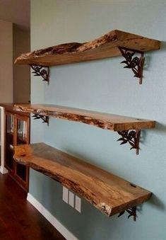 We used reclaimed maple slabs to create this wall shelving unit. After sanding and applying 5 coats of satin polyurethane ( 220 grit sanding between each coat), we attached the shelves to the wall using these beautiful purchased shelving brackets. Wood Shelf Brackets, Wood Shelves, Live Edge Shelves, Kitchen Shelves, Kitchen Wood, Dyi Bookshelves, Floating Shelves, Rustic Shelving, Live Edge Furniture