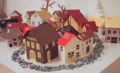 Advent calendar is made up of mini paper houses - add one to your Christmas village each day Christmas Time Is Here, Christmas 2014, All Things Christmas, Winter Christmas, Advent Calenders, Diy Advent Calendar, Christmas Projects, Holiday Crafts, Navidad Diy
