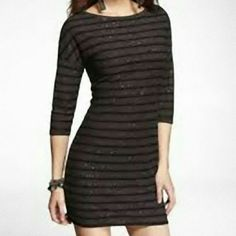 EXPRESS Sequin Sweater Dress New modestly sequined 3/4 sleeve sweater material EXPRESS dress with silk lining. Fun dress for winter time and boots! Can go from day to night wear very easily! Pull over dress, no zippers or buttons. Express Dresses Midi