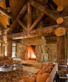 """Massive timber and stone fireplace. Those logs have to be 14"""" logs...which make a log home look so substantial and rustic!"""