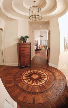 Stunning wooden foyer flooring by SVB Wood Floors, somewhere in the USA!