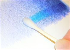 Rubbing alcohol is a great solvent for colored pencils. It breaks down the wax binder in most colored pencils and allows the pigments to blend more like paint.