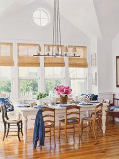 white dining room table with wooden chairs around it. This is so what I want but w/ more comfortable chairs.
