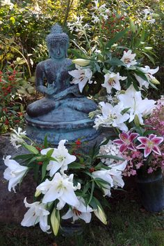 """This statue of the Buddha, that lived in my house growing up, was what was behind us as we got married. It wasn't an """"altar,"""" but as close as it comes for a secular/garden wedding, I guess. And it was easier than building an arch! The lily's smelled fantastic!! Home Altar, October 8, Altars, Budget Wedding, Garden Wedding, Got Married, Perfect Wedding, Wedding Stuff, Garden Sculpture"""