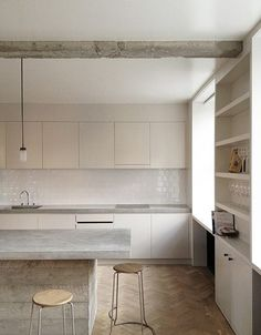 kitchen, interiors, white cabinets, subway tile, concrete, natural wood, herringbone floors