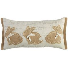 Ease into Easter with our enchanting bunny pillow. A vintage-inspired script pattern is the background for our stitched bunnies, and each end is flanged in matching strips. Ribbon bow ties and embellished tails add even more fun. A hidden zipper closure keeps it all neat and tidy long after everyone hops back down the bunny trail.