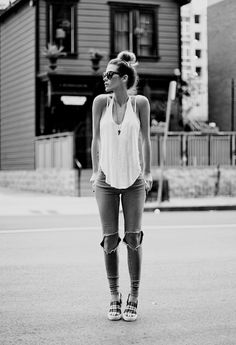 Casual style. Ripped jeans and white tank top.
