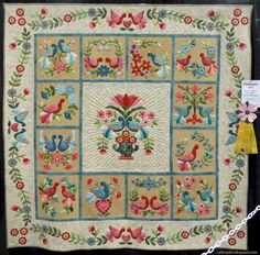 """A Little Bird Told Me I Could Applique"" by Marie Blunk. Pattern: My Tweets, Block of the Month by Erin Russek. Quilted by Nancy Mancke. 2015 AQS quilt show- Paducah.  Photo by Cathy Geier."