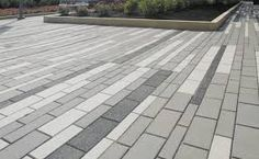 Granitex Paver / Tectura Design / Wausau Tile - I like the clean look of these, while still incorporating different colors, patterns, and widths