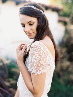 Vintage Bride with a Cap Sleeve Wedding Dress