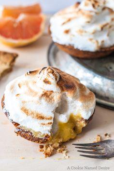 ginger vanilla bean grapefruit almond tart with ginger cardamom meringue