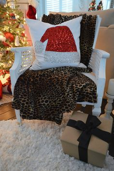 Absolutely in LOVE with the Red Sequin Santa Hat embellished pillow I found at @HomeGoods this season, it sparkles & shines in the light of the Christmas tree and it couldn't feel any more merry or magical! sponsored pin