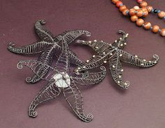 Here is a pile of inch starfish all worked in steel. One has goldplate over brass beads, and the other showcases white beach glass. Wire Wrapped Pendant, Wire Wrapped Jewelry, Metal Jewelry, Beaded Jewelry, Handmade Jewelry, Handmade Wire, Wire Crafts, Jewelry Crafts, Jewelry Art