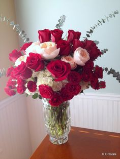 Red and pink romantic flower arrangement in crystal vase