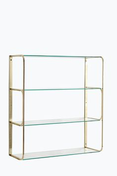 Vægreol med stel af messingfarvet metal og 4 hylder af glas. Ved at metalrammen er tilpasset kan du købe flere reoler og bygge på til siden. <br><br>Højde 66 cm. Bredde 57 cm. Dybde 22 cm. Leveres usamlet. <br><br>